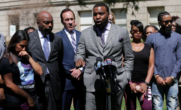 Attorney S. Lee Merritt , center speaks for the family of Diante Yarber who was shot at least 10 times by Barstow police and killed in what the family is saying is a case of excessive force after a video surfaced of the deadly Walmart parking lot shooting Monday in San Bernardino, Calif. April 23, 2018. (TERRY PIERSON,THE PRESS-ENTERPRISE/SCNG)