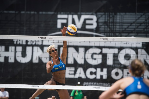 Alexa Strange spikes the ball for the final point of the match with her partner Falyn Fonoimoana, not pictured, during their 2-1 victory over fellow Americans Stacey Smith, at right, and Deveney Pula, not pictured, during the first day of the Huntington Beach Open, a beach volleyball event co-run by the AVP and FIVB, in Huntington Beach on Wednesday, May 2, 2018. (Photo by Kevin Sullivan, Orange County Register/SCNG)
