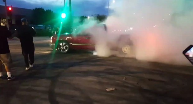 A pickup truck does a burnout at Plummer Street and Mason Avenue after a group of people illegally closed the intersection on Saturday, May 5, 2018. (Image from Twitter video)