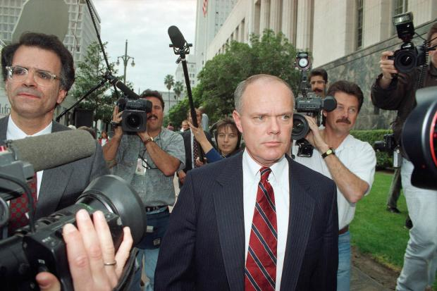 In this Feb. 4, 1993 file photo, Los Angeles police Sgt. Stacey Koon leaves the federal courthouse in Los Angeles after the opening session of the federal civil rights violation case against Koon and three other police officers involved in the beating of black motorist Rodney King. Koon was convicted and served time in federal prison. He was arrested May 1, 2018, on suspicion of DUI after a crash in Castaic. (AP Photo/Nick Ut)