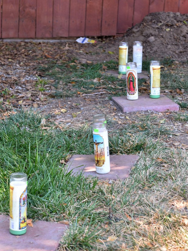 Candles have been placed at 525 W. 8th Street where Long Beach Police recovered a body buried in the backyard. The body is believed to be that of Zach Kennedy, 32, missing since October 2017. Long Beach May 4, 2018. Photo by Brittany Murray, Press Telegram/SCNG