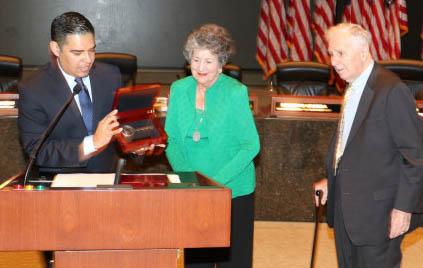 Long Beach Mayor Robert Garcia, left, presents keys to the city to Gloria Deukmejian and former Gov. George Deukmejian. (Courtesy photo)
