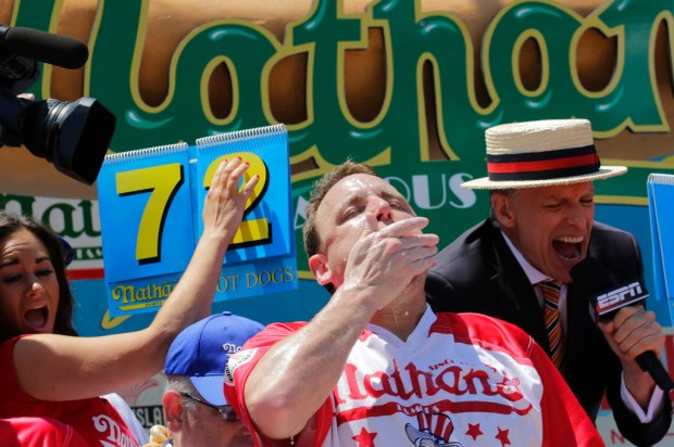 Joey Chestnut chows down during the Nathan's Annual Famous International Hot Dog Eating Contest, Tuesday July 4, 2017, in New York. Chestnut won, marking his 10th victory in the event. (AP Photo/Bebeto Matthews)