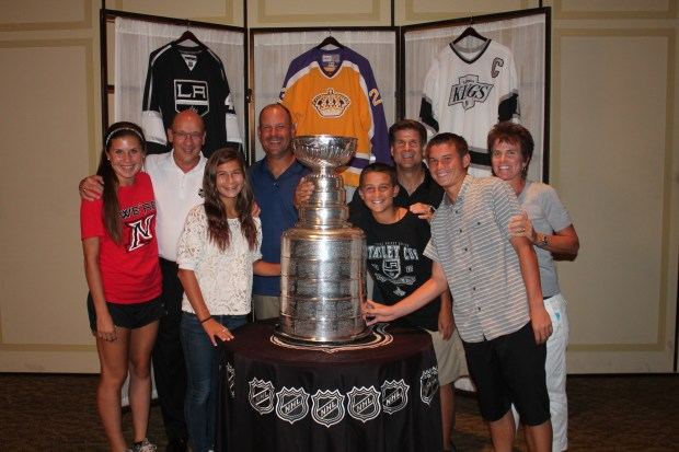 Donna Moskal, far right, celebrates the Kings' 2012 Stanley Cup victory with, from far left, daughter Kendall Moskal, Kings broadcaster Bob Miller, daughter Brianna Moskal, husband Tony Moskal, son Derek Moskal, Kings broadcaster Jim Fox and son Brendan Moskal. (Photo from the Moskal family)