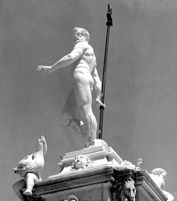 Undated photo circa 1968 shows the original Neptune statue. A close look reveals cracks in his lower legs and damage to the figure of a boy holding a dolphin, lower left. (Daily Breeze file photo)