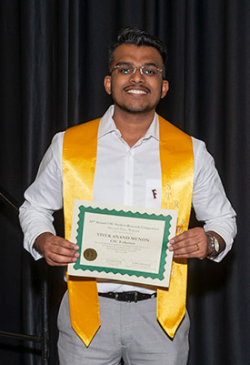 Cal State Fullerton student Vivek Anand Menon displays his award from the CSU Student Research Competition. (Photo courtesy of Cal State Fullerton)