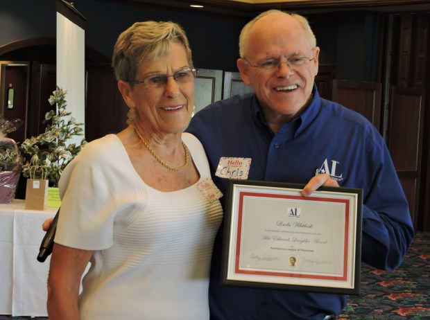 Linda Whitlock, left, receives the Ada Edwards Laughlin Award from Chris Jensen, newly elected president of Assistance League of Riverside. (Courtesy Photo)