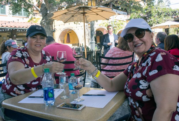 Guests enjoy wine at Disney California Adventure's Food & Wine Festival. Disney California Adventure has served alcohol since it opened in 2001, but Disneyland remains booze-free in public areas of the park. (File photo by Mark Eades, Orange County Register/SCNG) Taken in Anaheim at Disney California Adventure on Friday, March 10, 2017.