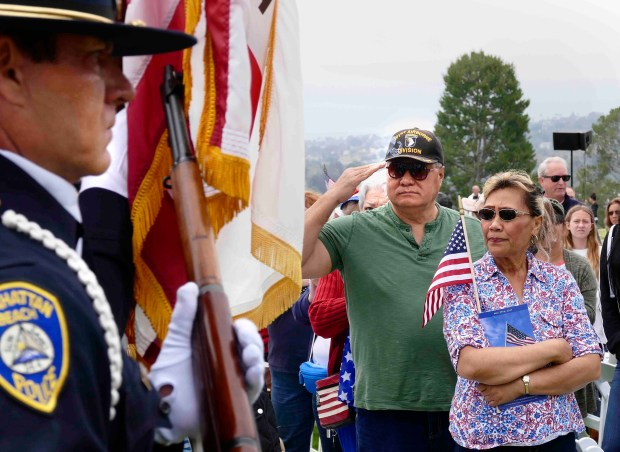 US Army veteran Val R. Toomalatai of Carson salutes the police color guard. Memorial Day Observance at Green Hills Memorial Park, Rancho Palos Verdes. Thousands atended the program paying tribute to the men and women who have lost their lives in defense of our country. Photo by Brad Graverson/The Daily Breeze/SCNG/05-29-17