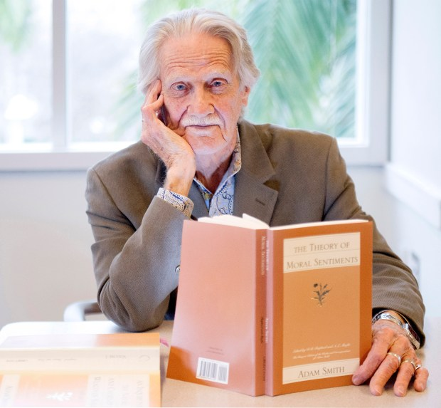 """Dr. Vernon Smith, Chapman University professor of economics and law, attends a course on """"Humanomics: Adam Smith and the Morality of Markets"""" with students on the Orange campus. (Photo by Cindy Yamanaka, Orange County Register/SCNG)"""