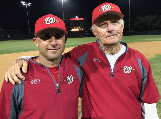 Woodbridge coach Ryan Brucker, left, with assistant coach Bob Flint Thursday night. Brucker played for Flint when Flint was the Irvine head coach. (Photo by Tim Burt, Correspondent)