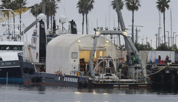Looking worn from its high-speed journey re-entering the atmosphere over the weekend, a SpaceX capsule is seen before 6 a.m. aboard the support ship NRC Quest arriving in San Pedro's Outer Harbor. (Photo: Chuck Bennett, for the Daily Breeze)