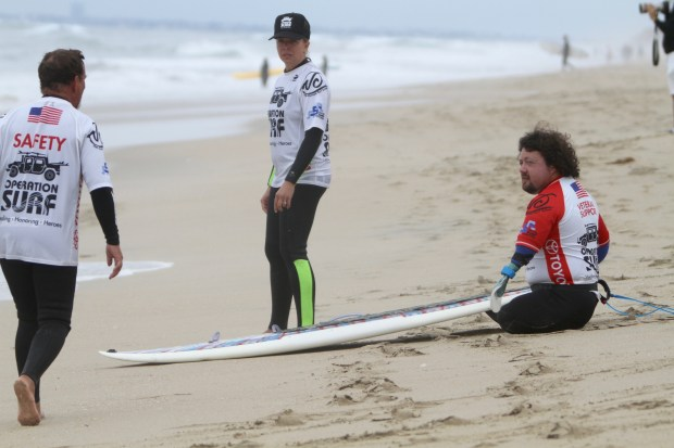 Operation Surf brings wounded veterans to Huntington Beach to catch waves during the week-long gathering. (Handout photo)