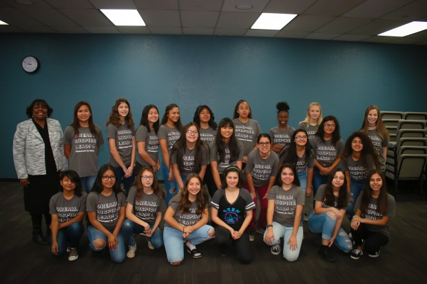 Girl Scouts, posing with Riverside County Superintendent of Schools Judy White, learn about engineering during the Introduce a Girl to Engineering Day event. Photo courtesy of Girl Scouts of San Gorgonio