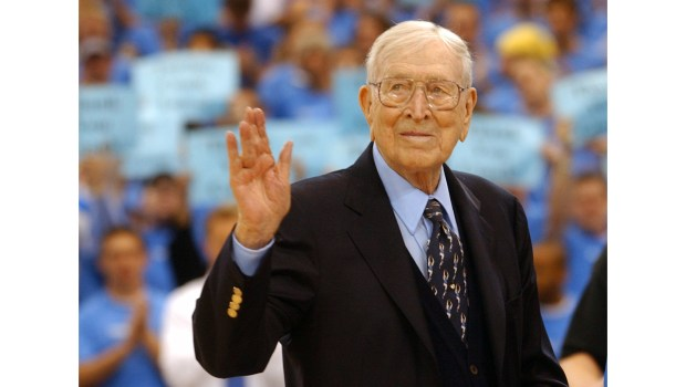 Former UCLA coach John Wooden, 93, greets the crowd during the dedication of Nell and John Wooden Court at UCLA's Pauley Pavillion. (File photo by Scott Varley/Daily Breeze)
