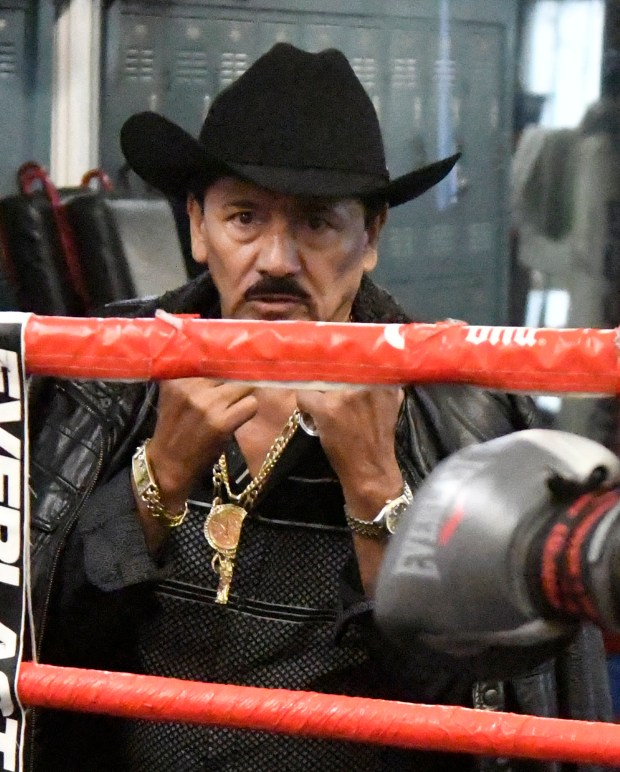 Leo Santa Cruz's father and trainer, Jose Santa Cruz, works with his son for his upcoming fight against Abner Mares on June 9. (Photo by Gene Blevins)