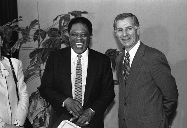 Remarks by Governor George Deukmejian, right, brings a laugh from San Francisco Giants great Willie Mays as he declared to be Willie Mays Day Monday, April 14, 1986, Sacramento, California. The event took place in the governor?s Capitol office in Sacramento. The former outfielder is now a special assistant to the team president. (AP Photo/Walt Zeboski)