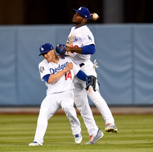 The Dodgers' Kike' Hernandez, left, and Yasiel Puig collide as Puig throws to second base during a May 9, 2018 game against the Diamondbacks at Dodger Stadium. (Photo by Hans Gutknecht, Los Angeles Daily News/SCNG)
