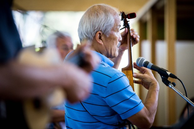 Chester Ikei, center, a senior advisor at JACCC, teaches seniors how to play ukelele with help from assistants Bob Takata, left, and Ken Nakaba during Ukes for Little Tokyo's weekly class at the Japanese American Cultural and Community Center on Thursday, April 26, 2018. The weekly Japanese language ukulele class for seniors is in its second year at the JACCC. (Photo by Sarah Reingewirtz, Pasadena Star-News/SCNG)