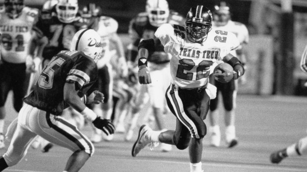 Chargers coach Anthony Lynn, right, seen during his playing days at Texas Tech in the 1989 All-American Bowl against Duke. (Photo courtesy of Texas Tech Athletic Department)