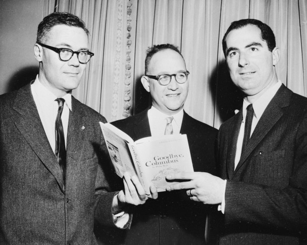 "FILE - In this March 24, 1960, file photo, the three winners of the National Book Award, Robert Lowell, from left, awarded for the most distinguished book of poetry, Richard Ellmann, won in the nonfiction category, and Philip Roth, received the award in the fiction category for his book ""Goodbye, Columbus,"" pose at the Astor Hotel in New York City,  Roth, prize-winning novelist and fearless narrator of sex, religion and mortality, has died at age 85. (AP Photo, File)"