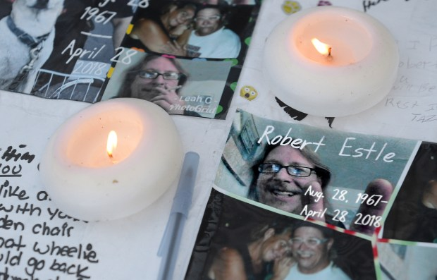 Robert Estle's death was memorialized on a table set up at a picnic for homeless people last month in Anaheim. Estle was found dead in a restroom at the Bridges at Kraemer Place on April 28. (Photo by Bill Alkofer, Contributing Photographer)