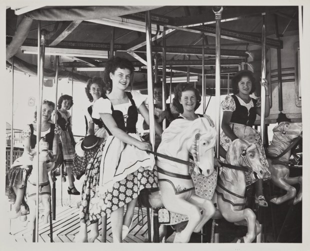 The 1949 Cherry Festival Queen and her Court ride a merry go round. (Photo courtesy Beaumont Cherry Festival Association)