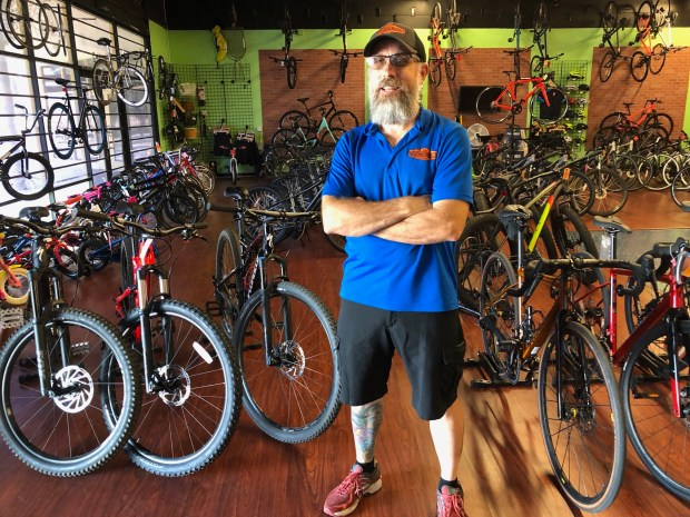 Dean Benson, owner of The Neighborhood Cyclery, said he welcomes the effort to breathe new life into the Festival -- but it may mean he will have to move his shop elsewhere. (Photo by David Downey, Staff)