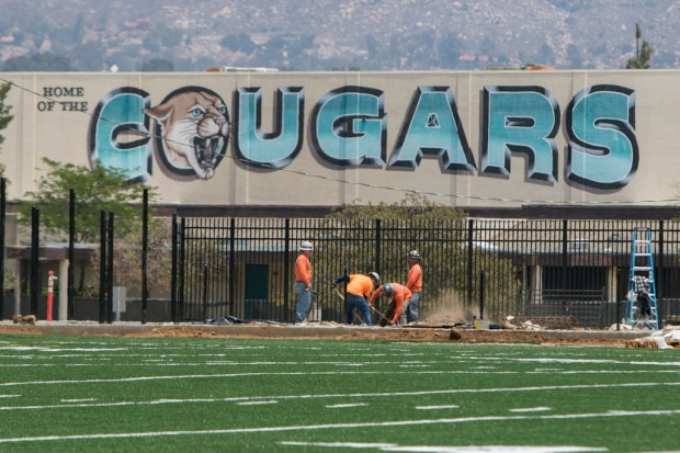 Construction crews work on the new home of the Canyon Springs Cougars on Wednesday, May 23. Officials say the stadium will be ready to host the school's June 6 graduation ceremony. (Photo by Andrew Foulk, contributing photographer)