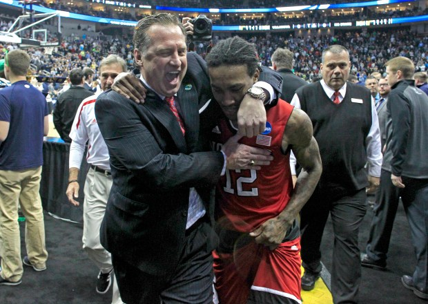 North Carolina State head coach Mark Gottfried celebrates with Cat Barber (12) after N.C. State's 71-68 victory against Villanova in the third round NCAA Tournament at the Consol Energy Center in Pittsburgh on Saturday, March 21, 2015. (Ethan Hyman/Raleigh News & Observer/TNS) ORG XMIT: 1165600