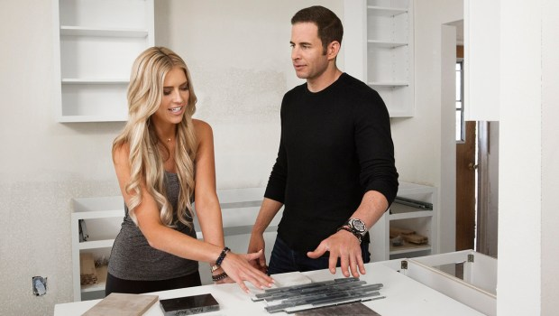 Christina and Tarek El Moussa compare options for floors and tiles meant for a Santa Ana home. (Photo courtesy of HGTV)