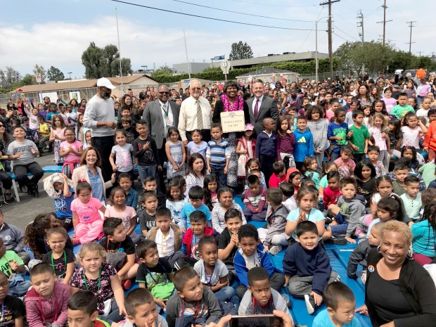 City and school officials were joined by youngsters at 118th Street Elementary School for a dedication of Marcia Reed Square in Harbor Gateway South. The intersection of 186th Street and Denker Avenue now honors Reed, shown in the photographs with Los Angeles City Councilman Joe Buscaino and Los Angeles School Board member Richard Vladovic.
