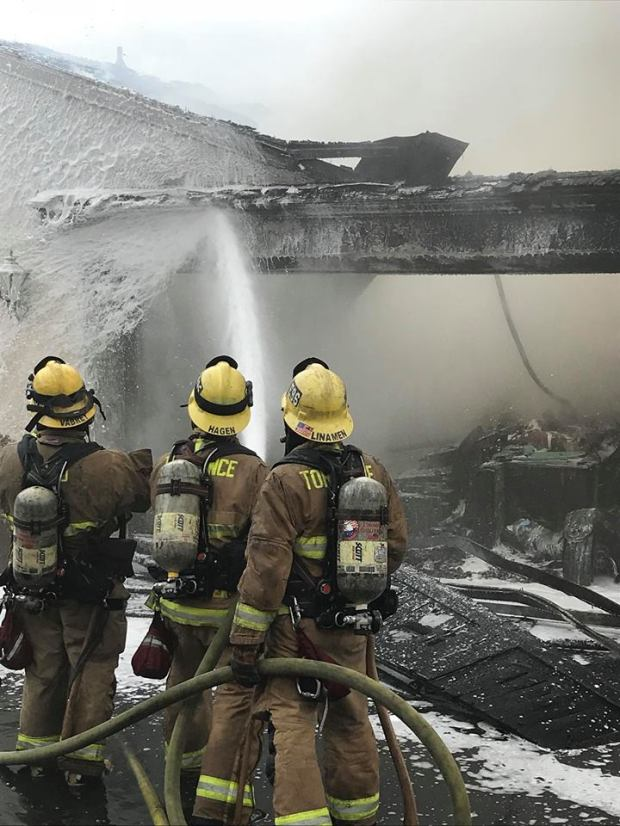Firefighters douse a home in the 4500 block of Via Corona in Torrance Saturday morning, May 12. (Courtesy of Torrance Fire Department)