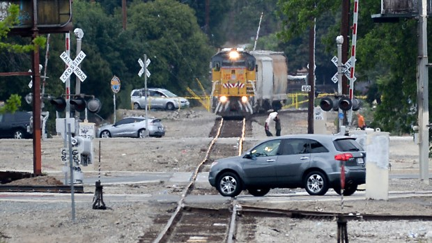 Motorists cross the Union Pacific tracks on Greenleaf Avenue in Whittier as a train approaches on Tuesday May 22, 2018. Union Pacific Railroad will be replacing the railroad crossings on several streets in Whittier because of expected increased activity. (Photo by Keith Durflinger for SCNG)