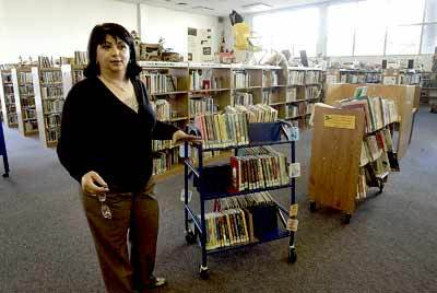Director of Library Services Paymaneh Maghsoudi, from the Whittier main public library, stands next to portable shelves on Thursday, March 5, 2009. Even after Maghsoudi says the library is in need of more space for everything they have.