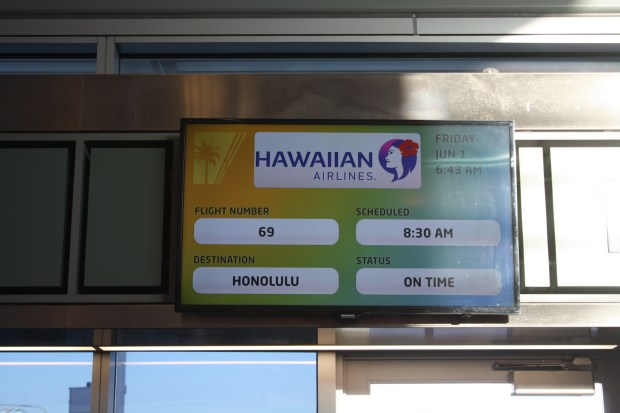 The sign above the Hawaiian Airlines gate at Long Beach Airport before the airlines' inaugural flight June 1, 2018