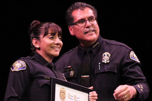 Honoree Jesenia Oropeza and Chief Robert Luna at the Long Beach Police Foundation's 50th Annual Police Awards Ceremonies, Thursday at the Carpenter Center. Photo: Tom Bray, SCNG
