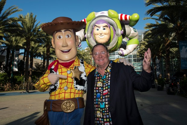 John Lasseter, film director, screenwriter, producer. strikes a pose with Woody at the Walt Disney Archives presents Disneyland The Exhibit at the D23 EXPO 2015 at the Anaheim Convention Center. //ADDITIONAL INFORMATION: Disney23 - 08/14/15 Ð ED CRISOSTOMO, ORANGE COUNTY REGISTER