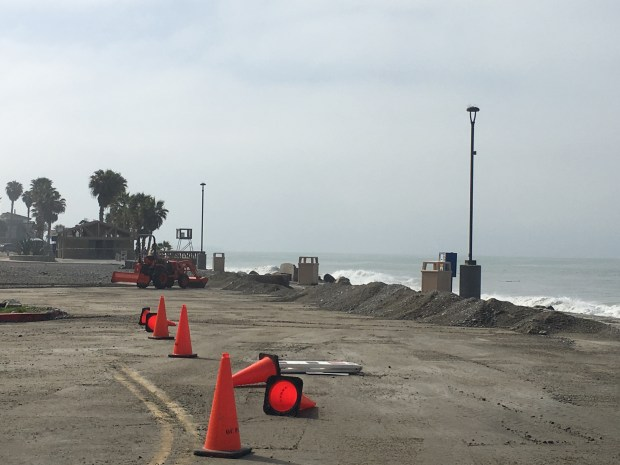 Cones block off entry into the Capo Beach parking lot as maintance crews work to clean up the mess caused by this week's storms. Photo: Laylan Connelly