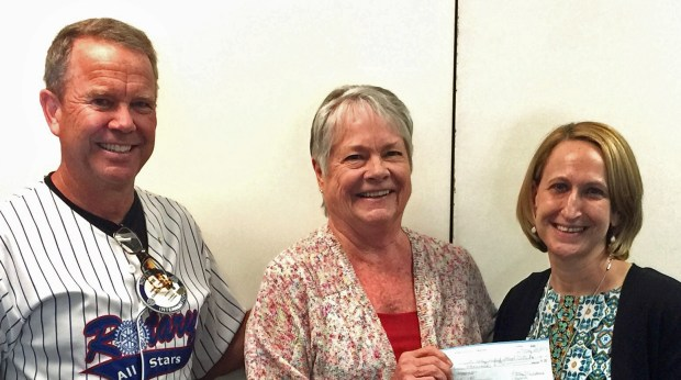 From left, Jim Yanoschik and LouEllen Ficke of the Rotary Club of Murrieta present a check for$3,000 to Faythe Mutchnick, Murrieta Valley Unified School District's executive director of elementary education, for theRead 180 program. (Courtesy Photo)