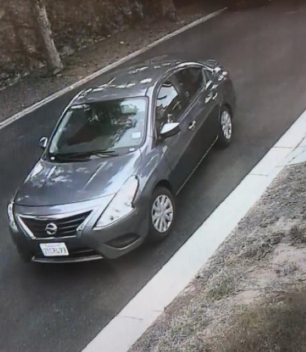 Long Beach police are looking for three suspects who fled in a dark gray Nissan Versa after burglarizing a Long Beach home and taking a family dog Sunday, June 17. (Courtesy of Long Beach Police Department)