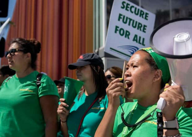 UC Irvine Medical Center admissions worker Stephanie Le, leads a chant with union workers outside the hospital in Orange in May 2018. In the wake of a U.S. Supreme Court decision, Janus vs. ASCME, in June 2018, public employee unions are protesting the outlawing of fair-share fees for collective bargaining. (Photo by Mindy Schauer, Orange County Register/SCNG)