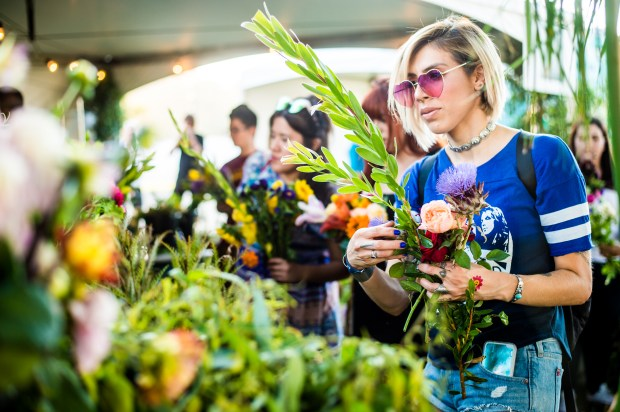 Music fans pick out flowers from Muir Ranch flowers during Arroyo Seco Weekend at Brookside Golf Course in Pasadena, Calif. on Sunday, June 25, 2017. (Photo by Watchara Phomicinda, The Press-Enterprise/SCNG)