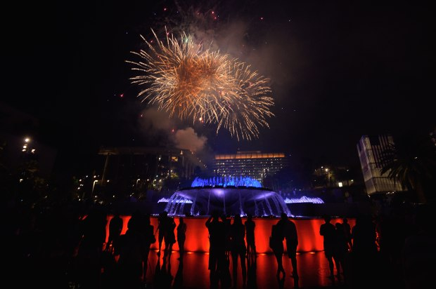 Fireworks and the fountain at the Dorothy Chandler Pavilion light up the night during the Grand Park 4th of July Block Party in downtown Los Angeles. (File photo)
