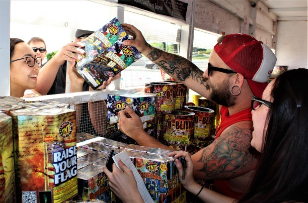 Customers buy state-approved fireworks at a TNT stand. (Photo by David Dickstein)