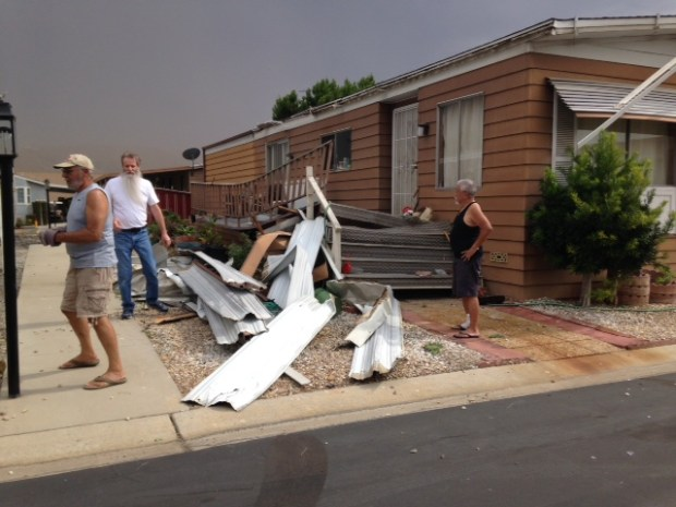 Residents of the Meadows Mobile Home Park on Pierce Street in Riverside survey the damage after a storm ripped metal pieces off some homes on Aug. 31, 2017. (Courtesy of Judie Kemp)