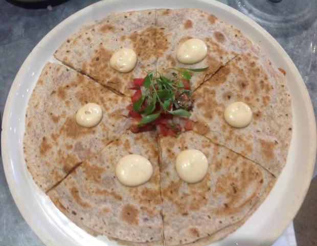 The chicken tinga quesadilla at El Jefe is filled with shredded chicken, chipotle cream sauce, chihuahua cheese and pico de gallo. Each piece has a dollop of chipotle cream sauce. (Photo by Dorene Cohen)