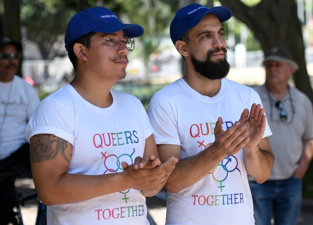 """(l-r) Dave Maldonado and Noah Reich applaud. In remembrance of the 49 people who were killed in a mass shooting on June 12, 2016 at the Florida night club Pulse, and to bring awareness to the 700 people who have died as a result of gun violence since that time, """"National Die-In Day"""" was held at Los Angeles City Hall. People held up picket signs, listened to speeches, and at noon they laid down on the ground in a simulated death. Los Angeles, CA 6/12/2018 (Photo by John McCoy)"""