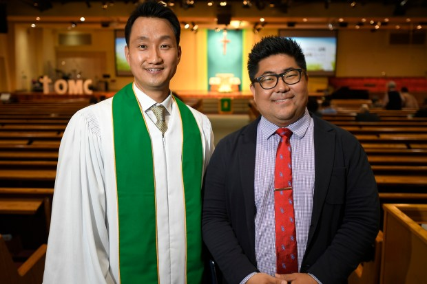 From left, Chihoon Kim, Senior Pastor at Oriental Mission Church with Rev. Daeseung Son after Sunday services in Los Angeles. (Photo by John McCoy, Contributing Photographer)