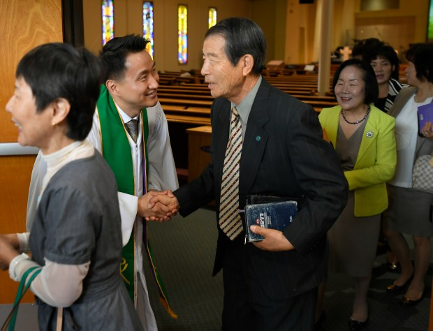 Chihoon Kim, Senior Pastor at Oriental Mission Church, greets his congregation after morning services in Los Angeles. (Photo by John McCoy, Contributing Photographer)